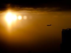descent (miemo) Tags: city travel winter sky urban sun building skyscraper plane airplane flying europe tallinn estonia olympus ep1 omzuiko100mmf28