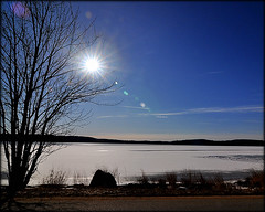 Sun Power (blamstur) Tags: blue sun lake ice frozen pond massachusetts flare brookfield 15challengeswinner quaboagpond
