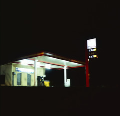 petrol station (chopchops) Tags: longexposure light summer france color colour 120 6x6 tlr film bulb architecture night mediumformat dark square photography town long exposure dof shot bokeh scanner artificial gas professional nighttime hour pro epson imaging 24 e6 2009 f28 ai perfection flatbed twinlensreflex petrolstation mamiyac330 vinca 80mm silverfast mamiyasekor v750 fujifilmvelvia100 lasersoft epsonperfectionv750pro externalmetering epsonperfectionv750