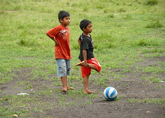 Barefoot footballers (jeremyhughes) Tags: city red urban bali color green boys indonesia football nikon asia zoom barefoot stony recreation colourful d200 players nikkor vr ubud footballers 18200mm 18200mmf3556gvr