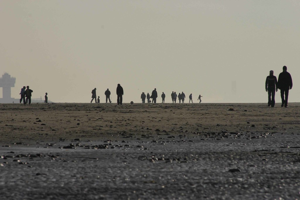 People and Ironmen on Crosby beach Christmas 2006