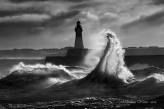 Shining Waves (Explored) (linlaw39) Tags: blackandwhite bw lighthouse seascape storm nature weather clouds mono scotland interestingness interesting gallery waves aberdeenshire wave explore northsea crashingwaves fraserburgh naturesfinest theworldwelivein supershot likethis stormysea explored competiti