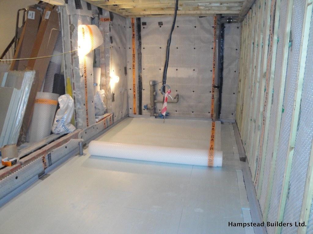 Waterproofing a basement floor