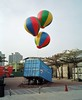 Two seconds later it broke free of the ground and floated off over the city (deepstoat) Tags: art 120 film mediumformat balloons hotair taiwan container helium roll mamiya7ii kodakportra deepstoat
