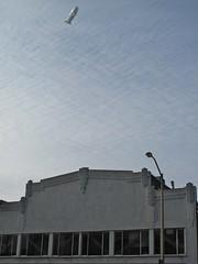 Airship over 564 Bryant Street (Anomalous_A) Tags: sanfrancisco california sky architecture clouds buildings architecturaldetail blimp airship artdeco soma deco southofmarket dirigible bryantstreet