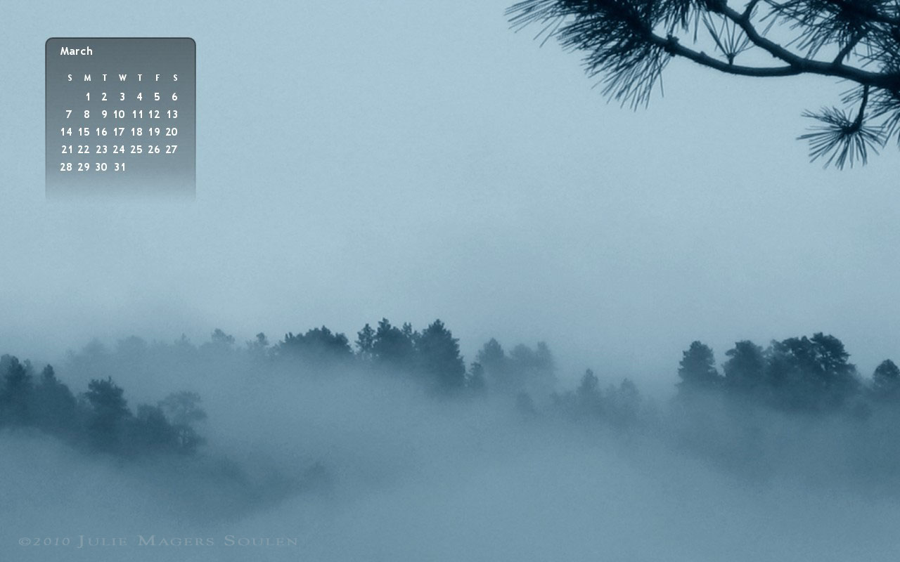 March 2010 Wallpaper Calendar with blue foggy pines and hills