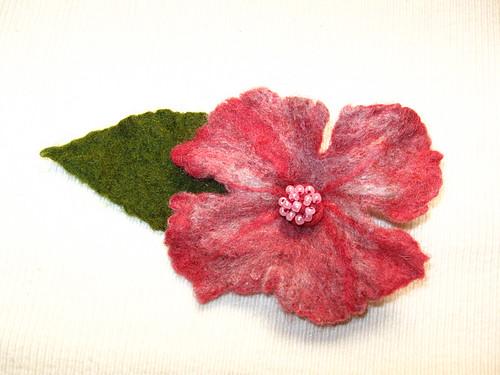 Ravelry: Knit Earwarmer with Crochet flower pattern by Ashlee Prisbrey