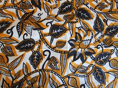 African print cotton: Orange and blue leaves and vines.