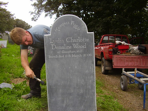 Fixing gravestone in Morwenstow