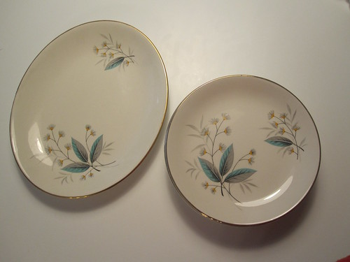 6 small plates and a serving plate