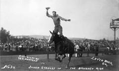 Cowboy Jason Stanley performing a riding trick...