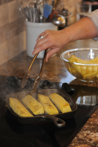Grilling the pineapple flanks adds a rich, charred flavor