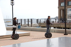 "People riding Segway scooters by the ""Ope..."