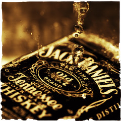 A Splash Of Jack (Samantha Nicol Art Photography) Tags: brown water square jack mono drops drink tennessee whiskey alcohol daniels whisky toned nsplash