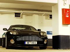 Aston Martin V12 Vanquish (FDJeux_Photography) Tags: green digital photoshop lens with martin garage hamburg olympus 420 racing 150 v e april british editing 40 mm 12 dslr passage zuiko aston hof 2010 v12 cs4 objektiv 40150mm blacknew e420 fdjeux bleichenhof vanqish