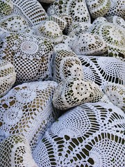 Lots of patterns and texture (woolly  fabulous) Tags: white rocks stones lace lacy ecofriendly doilies thifted