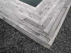 Wood, Water and Gravel (Moonlight Witch) Tags: wood sunset black water oslo night grey lights evening angle dusk geometry structure line norwegian gradient nightlife striped gravel scandinavian