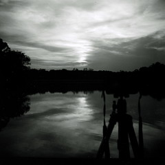 Photography versus video (kevin dooley) Tags: camera eve sunset bw cloud white lake black 120 film water look rollei analog flow photography photo video illinois still lomo lomography photographer technology time dusk cam tripod snap retro il plastic diana photograph observe experience medium format timetravel 100 subliminal tones cheap consciousness temporal judgment lakeofthewoods reaction impossible immediate observer conscious stoptime cloudage stillphotography mahomet cloudshot oldschooldigital stillphotographs