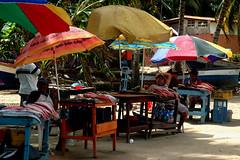DSC_vendeurs de poissons (ichauvel) Tags: fish man women village poissons parasols vendeurs vénézuela amriquedusud