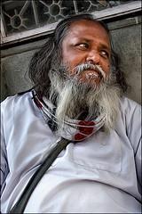 Tummy easy listening (oochappan) Tags: travel india standing ef1635mmf28lusm uttaranchal sadhu 2010 haridwar northindia 1325 img1431 colorsofindia oochappan indianphotography lifeinindia canoneos7d templescene 20100202