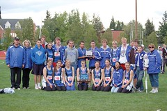 The Crane track teams gather around their trophies won at the 1A state meet in Monmouth. (Submitted photo)