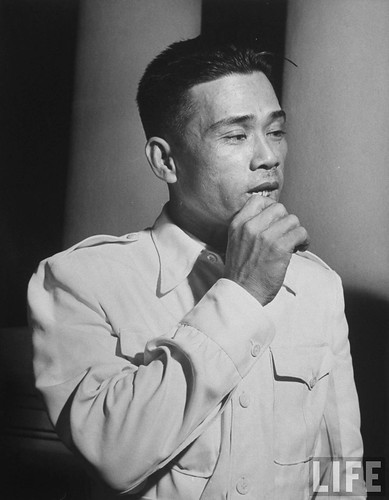 Saigon, July 1948 - French Indo China Government official Vien Bay, holding his hand up to mouth.