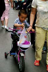 PinkIsNotAGirlsColour! (FotoFreaQ) Tags: china street city pink boy urban bike ride shanghai carry 2010