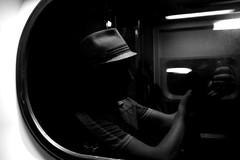 myself (damonabnormal) Tags: street city urban blackandwhite bw selfportrait reflection philadelphia window glass train canon mirror may streetphotography pa philly septa phl 2010 215 meandmycamera 40d