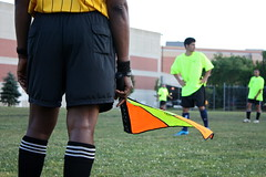 Wavin' Flag (mofya.sinjela) Tags: park ny newyork game color sports grass ball buildings outdoors football goal referee team call dof bokeh fifa flag soccer card numbers jersey worldcup players waving soon league teammates ref linesmen wavinflag