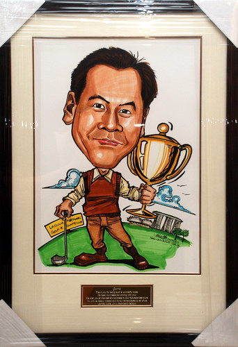 Golfer caricature with trophy framed with engraving plate
