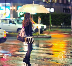 Cute lady in the rain.   (Hirosaki Japan).  Glenn Waters.  Over  8,000 visits to this photo.  Thank you. (Glenn Waters in Japan.) Tags: street woman cute rain fashion japan lady night reflections japanese lights nikon bokeh noflash aomori hirosaki japon     d700 nikond700  glennwaters nikkor85mmf14g nikkorafs85mmf14g