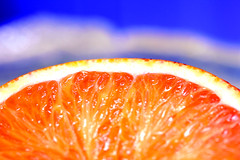 Orange (CristalArt) Tags: blue red white macro colors yellow fruit digital canon photography blurry focus citrus