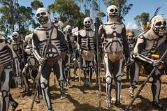Skeleton Men (Dave Schreier) Tags: new travel men boys face dave walking skeleton photography guinea sticks nikon paint photographer tribal tribe papua schreier d700