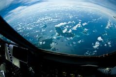 2009 12 17 Christmas Drops 020 (spitfireap) Tags: christmas airplane islands flying drops pentax fisheye tropical airforce guam hercules c130 micronesia airdrop 1017mm k20d christmasdrops