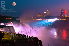 Niagara Falls (a2roland) Tags: niagara falls new york city ny buffalo peace bridge norman zeb a2roland a2rolandyahoocom scene pic flickr photo night long exposure water lights blue red moon haze fog waterfall waves people fence shadows mist maid all xpress us allxpressus gettyimages getty images image stock id 139997523 © photography rights reserved