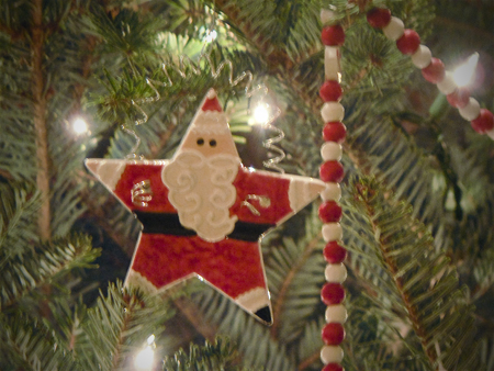 ceramic star santa ornament