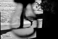 Light Man walking (Donato Buccella / sibemolle) Tags: street blackandwhite bw italy milan lightbulb milano streetphotography 50mm18 viamanzoni canon400d authenticphotography sibemolle fotografiastradale