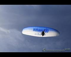 Hoffentlich ALLIANZ versichert... (mcPhotoArts) Tags: germany bayern deutschland bavaria bluesky paragliding paraglider garmischpartenkirchen gleitschirm allianz gleitschirmflieger canoneos400d sigma1770mm2845dcmacro photoshopcs4 bumblebeephotografix ffgapashow