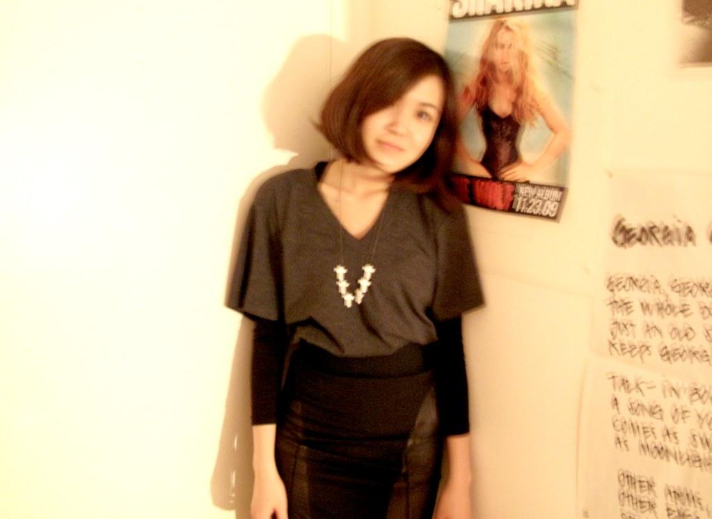 alex & chloe white cross necklace. torn by ronny kobo grey shoulder-pad v-neck tee. bcbg black mini skirt 1