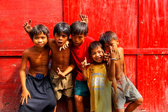 Children of Smoky Mountain, Manila (Mio Cade) Tags: charity boy red portrait girl work project children garbage asia village child labor philippines poor dump help aid human charcoal rubbish manila care scavenger smokymountain fund baseco tondo ulingan