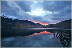 BUTTERMERE SUNSET, LAKE DISTRICT (IMAGES OF WALES.... (TIMWOOD)) Tags: trees sunset england lake snow mountains ice water clouds fence reflections pier rocks stones jetty sony lakes lakedistrict calm hills snowcapped cumbria serene stillwater bouy alpha a700 northwestengland nwengland