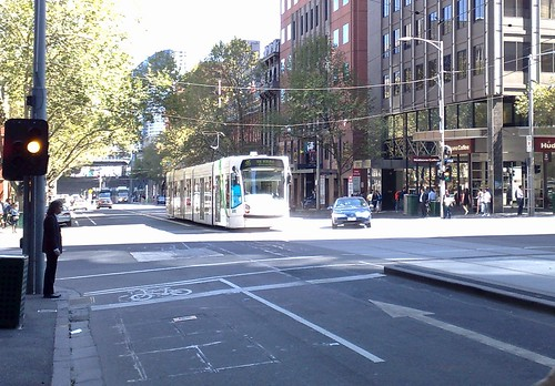 King/Bourke Sts - tram and right-turning car