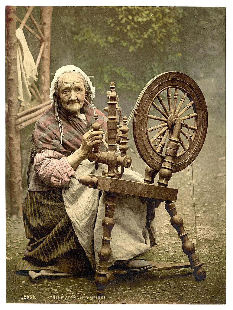 Irish spinner and spinning wheel. County Galway, Ireland