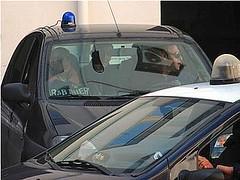 Andrea Tagliavini condotto dai carabinieri in caserma