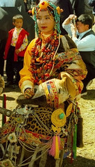 gorgeous girl in ceremonial costume at litang festival, tibet (BetterWorld2010) Tags: tibetans coral festival gold amber necklace beads costume treasure dress jewelry tibet ring celebration bracelet amdo kham sichuan traditionalcostume litang headdress robes yushu  tibetanwoman    khampa golok lithang tibetangirl tribalcostume tibetanfestival  tibetanwomen dzibead tribaljewelry tibetanjewelry tibetanfashion  horseracefestival ceromonialcostume