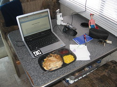 Hungry Man turkey dinner on the RV table with Charlie and my laptop.