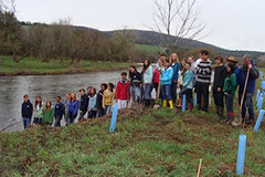 Planting a riparian barrier...and posing