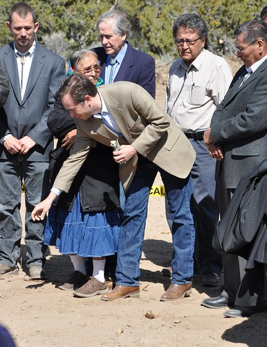 New Mexico Rural Development State Director Terry Brunner (center) participates in a traditional Navajo blessing by sprinkling corn pollen on the ground during the dedication ceremonies for the Eastern Navajo Waterline in northwest New Mexico.