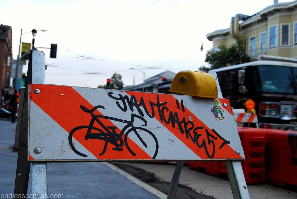 Jaut cares bike graffiti in san francisco california.