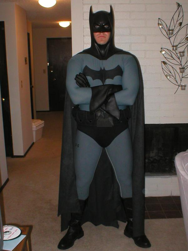 The suit is white under armor dyed with Rit Gray dye packets. The bat emblem is painted on using jacquard fabric paint. The belt is from a military surplus ... & Batman comic costume